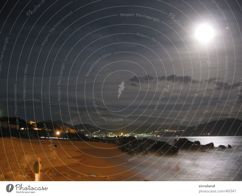 Stormy Mediterranean Sea Beach Night Flashy Ocean Black Yellow Brown Surf Roaring White crest Waves Cliff Clouds Corsica Propriano France Long exposure