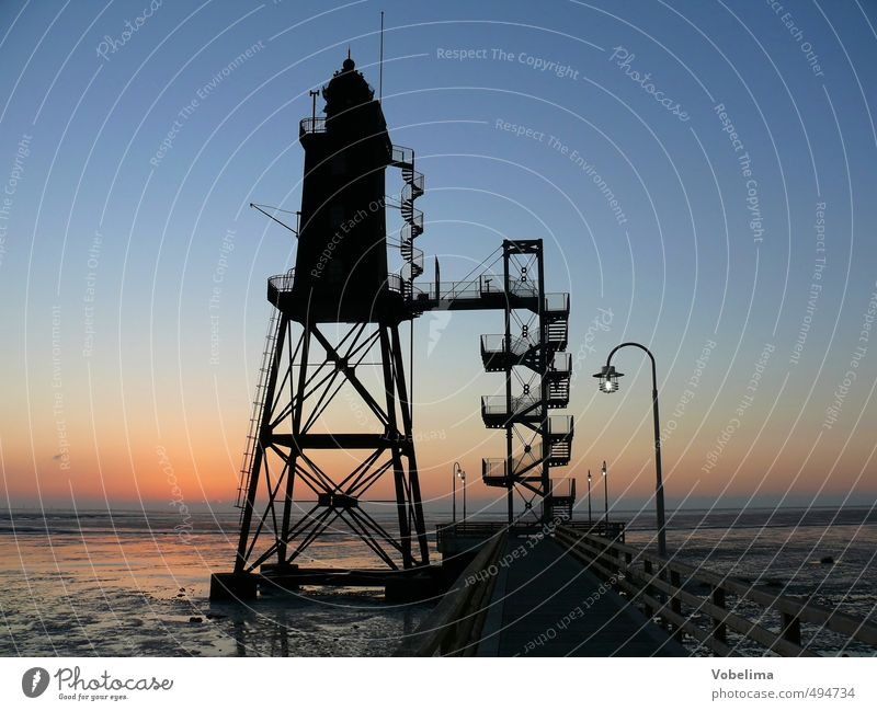 Lighthouse in Dorum Neufeld Ocean Port City Manmade structures Building Architecture Tourist Attraction Landmark Navigation Horizon Colour photo Exterior shot
