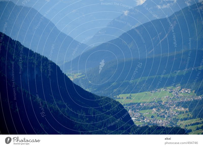 In Trento, Italy mountains Valley Village Landscape Fassa Valley Teleperspective Telephoto lens Mountain Clouds Vacation & Travel Tourism Exterior shot