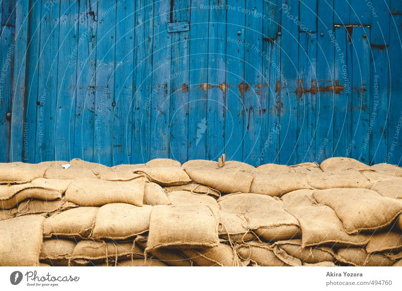 flood defence measure Wall (barrier) Wall (building) Wood Build Lie Retro Blue Yellow Bravery Success Safety Protection Effort Attachment Sandbag Stack