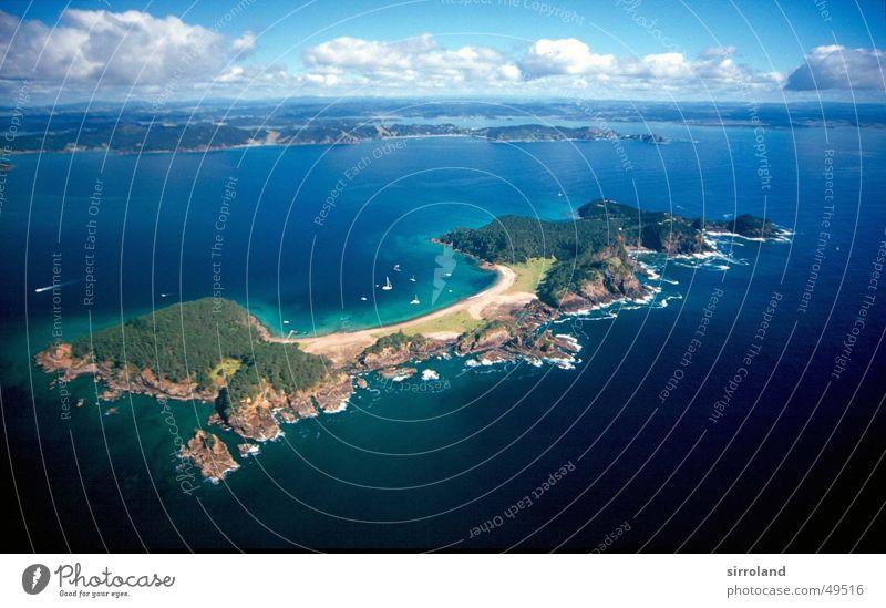 Bay of Islands New Zealand North Island Helicopter Aerial photograph Bird's-eye view Clouds Beach Ocean Green Waitangi Paihia fair weather Flying Aviation Blue