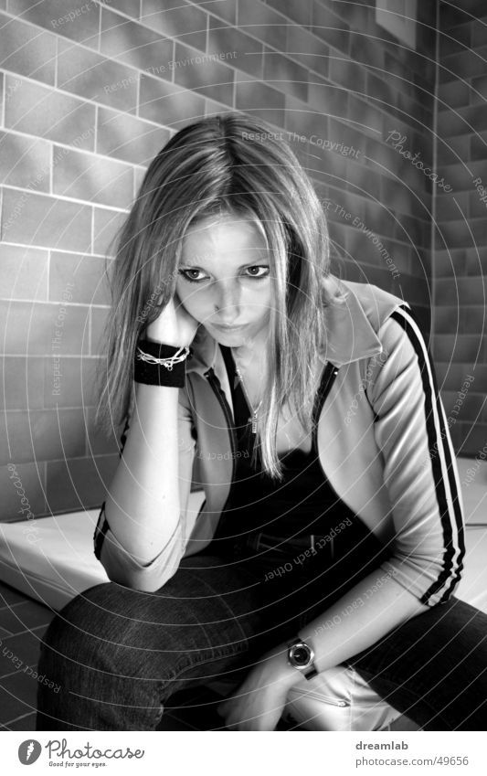 Sitting Girl Gloomy Sulk Crouch Wall (barrier) Sterile Cold Placed Portrait photograph Woman Boredom prison Prison cell Black & white photo Contrast boring set