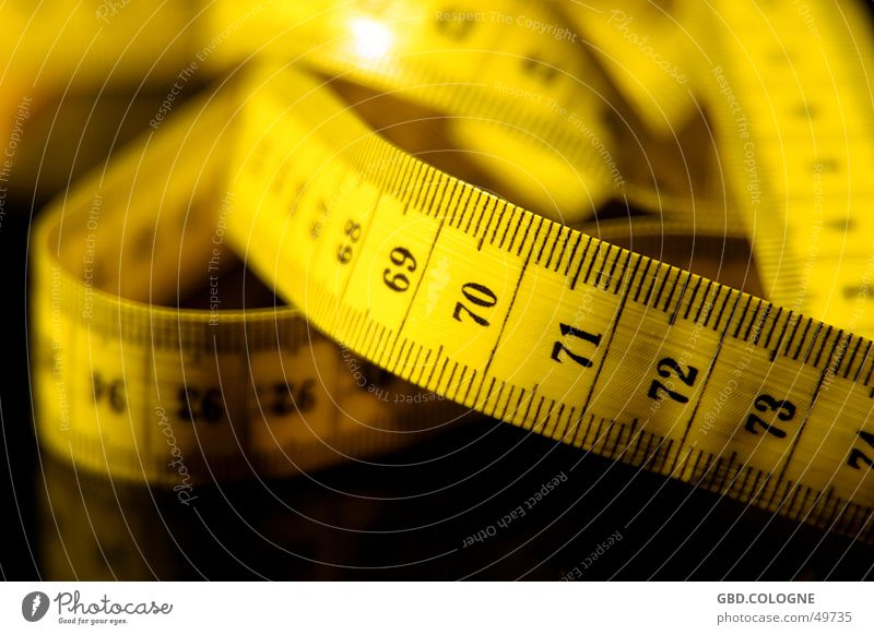 Putting on weight again... Centimeter Millimeter Diet Unit of measurement Tape measure Yellow Depth of field Digits and numbers Nutrition Measuring instrument