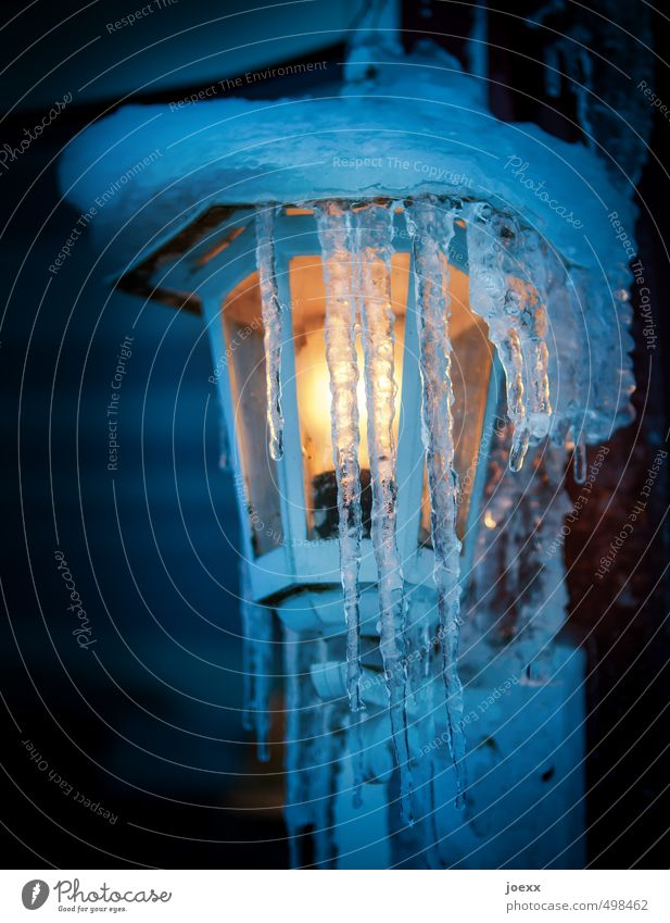 Appearance and Being Winter Ice Frost Snow Illuminate Bright Cold Blue Yellow Moody Hope Icicle Lamp Colour photo Multicoloured Exterior shot Close-up Deserted