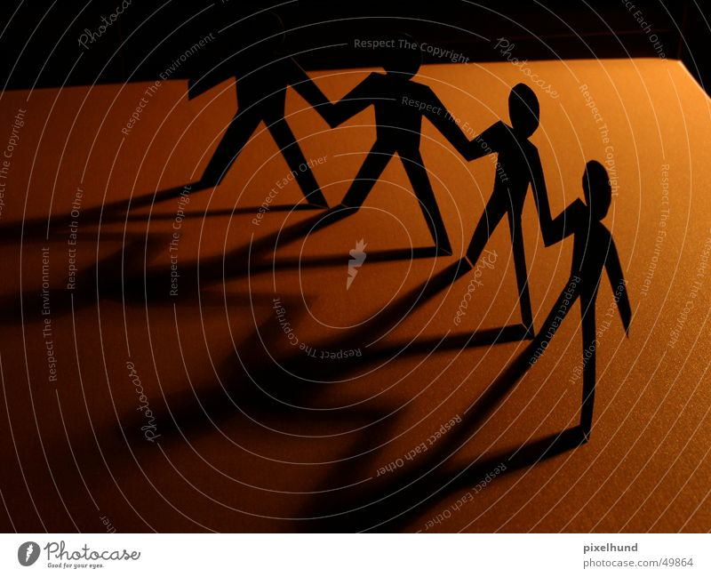 together Network Hold hands Friendship Together Brown Paper friends shadow Company Target cut manny