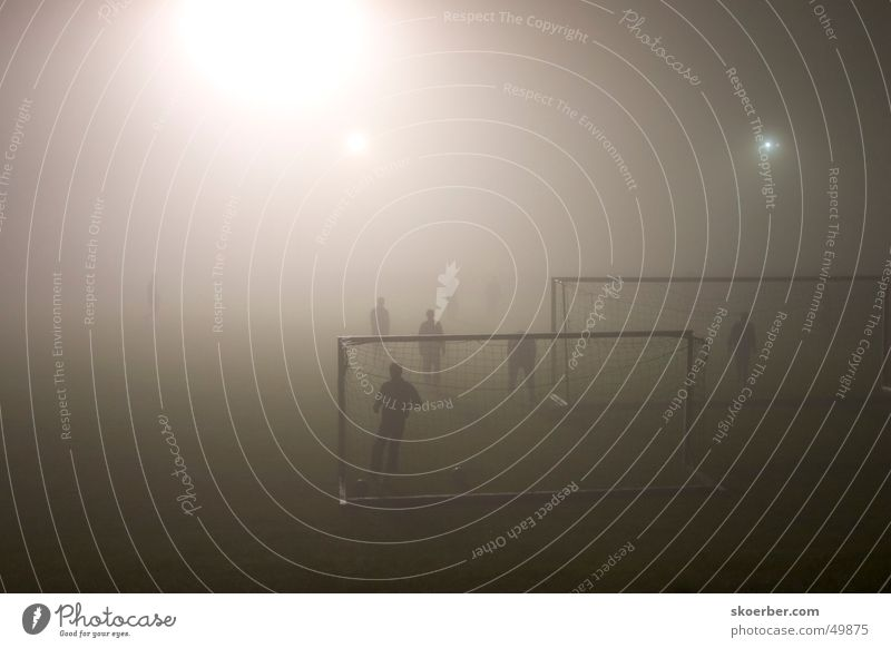Football match in fog Fog Floodlight Soccer Gate Lawn amateur football field Sports Training