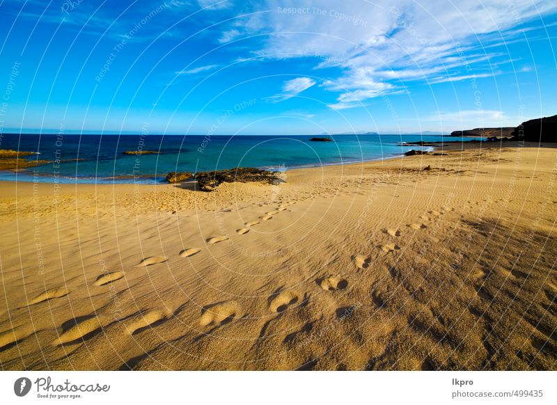 footstep Sky Nature Vacation & Travel Blue Summer Relaxation Ocean Landscape Clouds Beach Yellow Coast Stone Brown Rock Sand