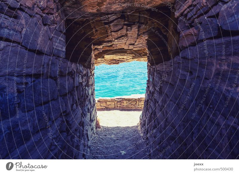 Nature Vacation & Travel Blue Old Beautiful Water Summer Ocean Wall (building) Lanes & trails Wall (barrier) Freedom Stone Rock Brown Beautiful weather