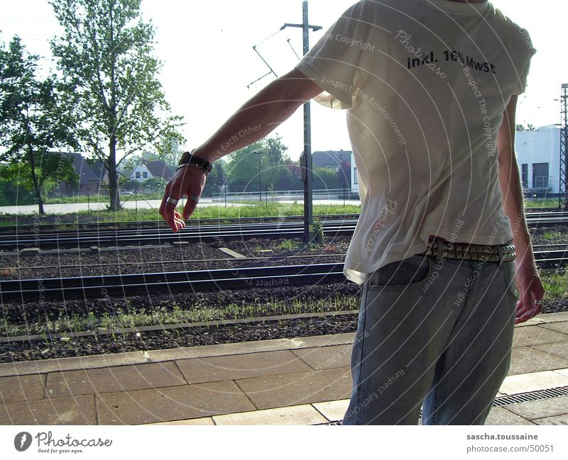 Man Hand White Tree Sun Green Blue Brown Arm Wind Poverty Railroad Dangerous Jeans T-shirt Digits and numbers