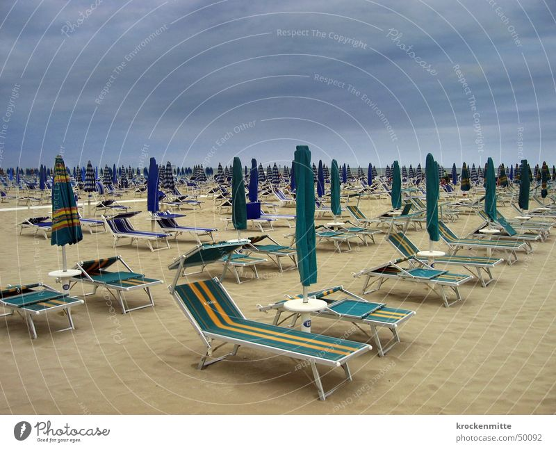 Beach Vacation & Travel Rain Empty Italy Gale Sunshade Deckchair Sandy beach Clouds in the sky Summer vacation Beach vacation Cervia