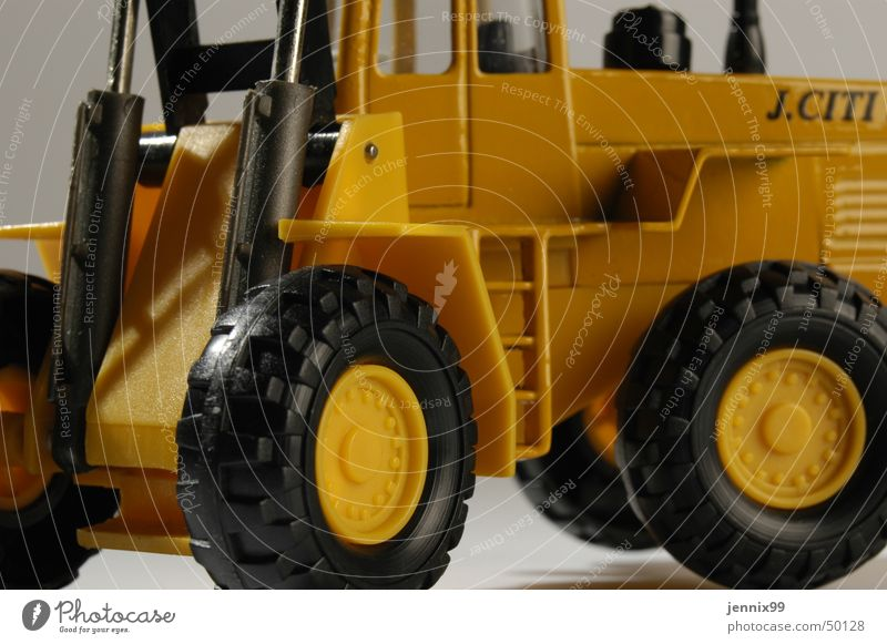 Colour Yellow Bright Construction site Toys Ladder Partially visible Excavator Wheel loader