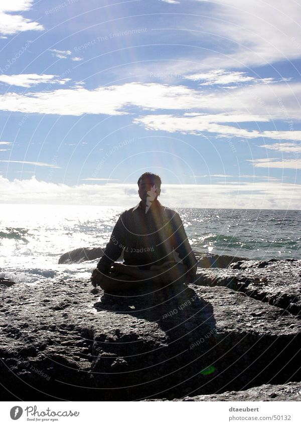Human being Water White Sun Ocean Green Blue Black Clouds Relaxation Stone Religion and faith Coast Rock Meditation