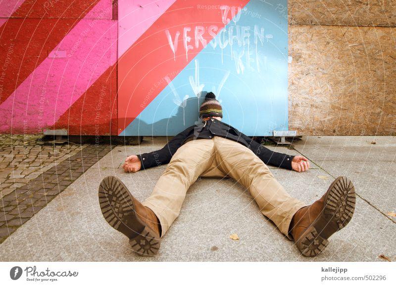 gift gaul Human being Masculine Man Adults Body Legs Feet 1 30 - 45 years Characters Graffiti Arrow Lie Cap Footwear Jacket Pants Fence Hoarding Donate Gift