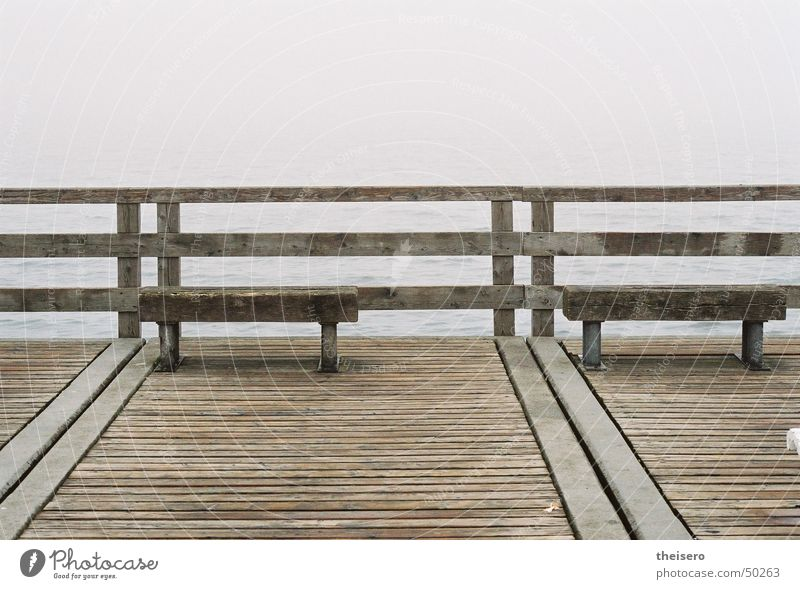 outlook into nothing Ocean Water Horizon Autumn Bad weather Fog Coast Baltic Sea Bridge Tourist Attraction Wood Dark Gloomy Loneliness Sea bridge Bench Empty