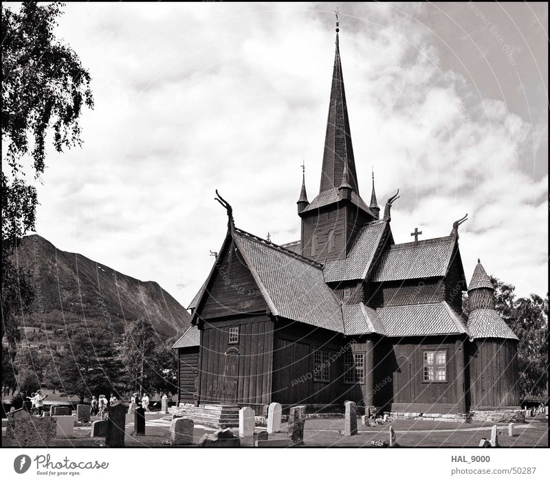 Stavkirke b/w Manmade structures Wood Clouds Grave Tombstone Grass Norway Scandinavia Historic Vikings Religion and faith Christianity Panorama (View) Roof