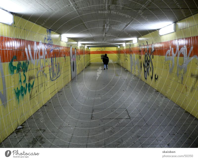 modern underground!? Lamp Human being Train station Bridge Tunnel Pedestrian Graffiti Old Dirty Gloomy Loneliness Premiere Ostbahnhof Painted Wall (building)