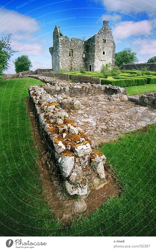 Sky Green Blue Summer Clouds Colour Garden Wall (barrier) Landscape Construction site Castle Manmade structures Ruin Northern Ireland Medieval times