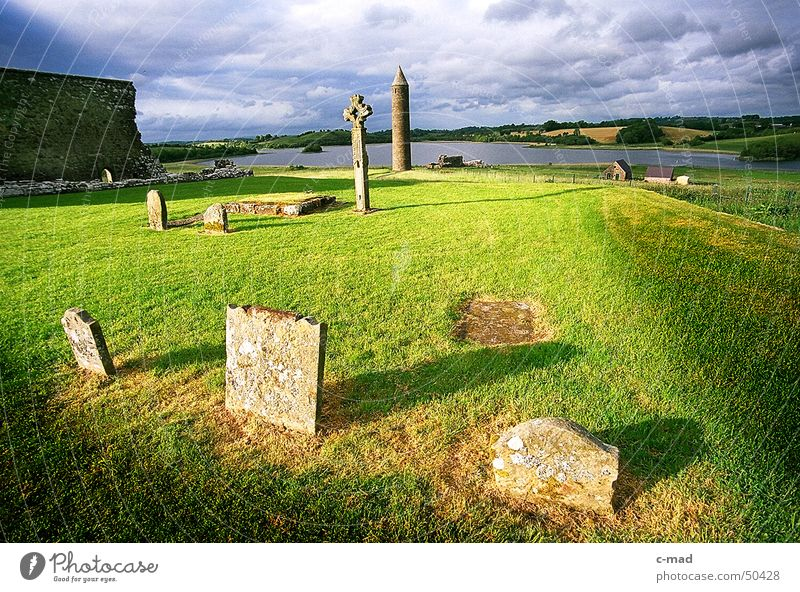 Cemetery on Derwenish Island Northern Ireland Manmade structures Ruin Wall (barrier) Clouds Summer Grave Meadow Green Celtic cross Celts Christianity