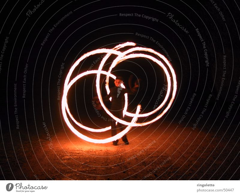 In the circle of fire Juggle Night Acrobatics Shows Romance Art Round Fiery Exterior shot Night shot Blaze Bright artistic Tasty Artist Elegant