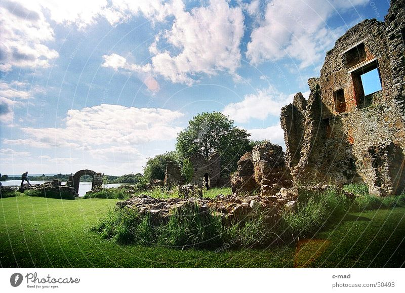 Crom Castle on Lough Erne Northern Ireland Ruin Manmade structures Lake Clouds Park Green Gray Summer River Water Tower castle Construction site