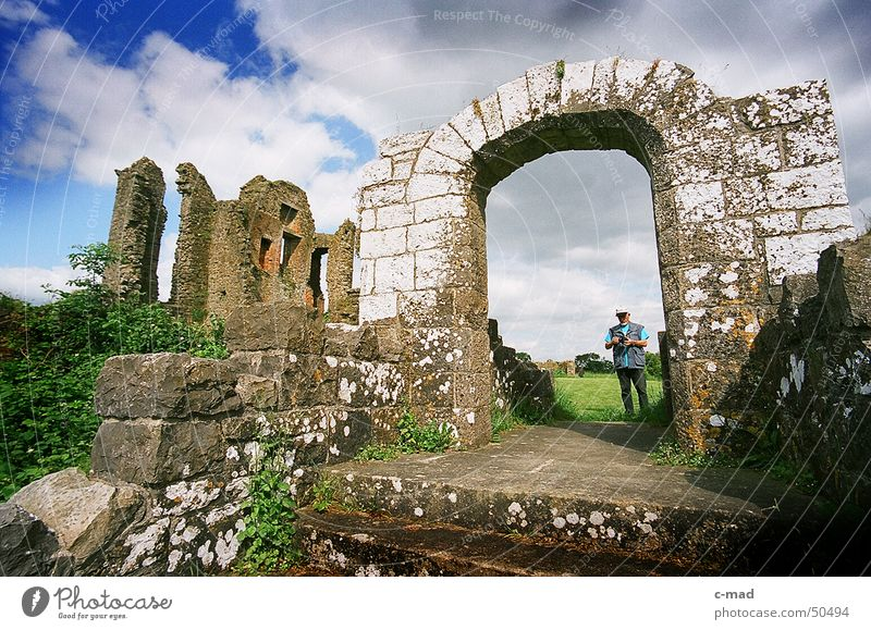 Crom Castle on Lough Erne Northern Ireland Ruin Manmade structures Archway Tourist Wide angle Lake Clouds Park Green Gray Summer River Water Tower castle
