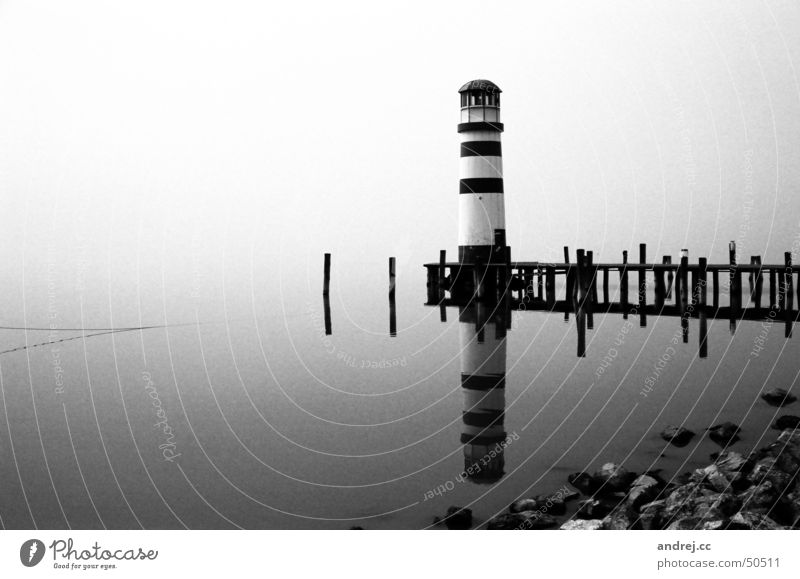 lighthouse Lighthouse Fog Dreary Footbridge Loneliness Reflection Water Gloomy Black & white photo Lake Neusiedl Landscape