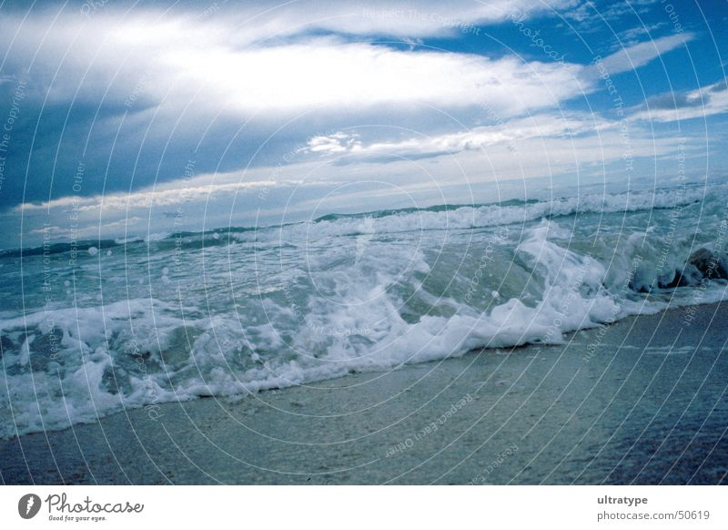 Water Sky Ocean Beach Vacation & Travel Clouds Lake Sand Waves Coast Surf High tide White crest
