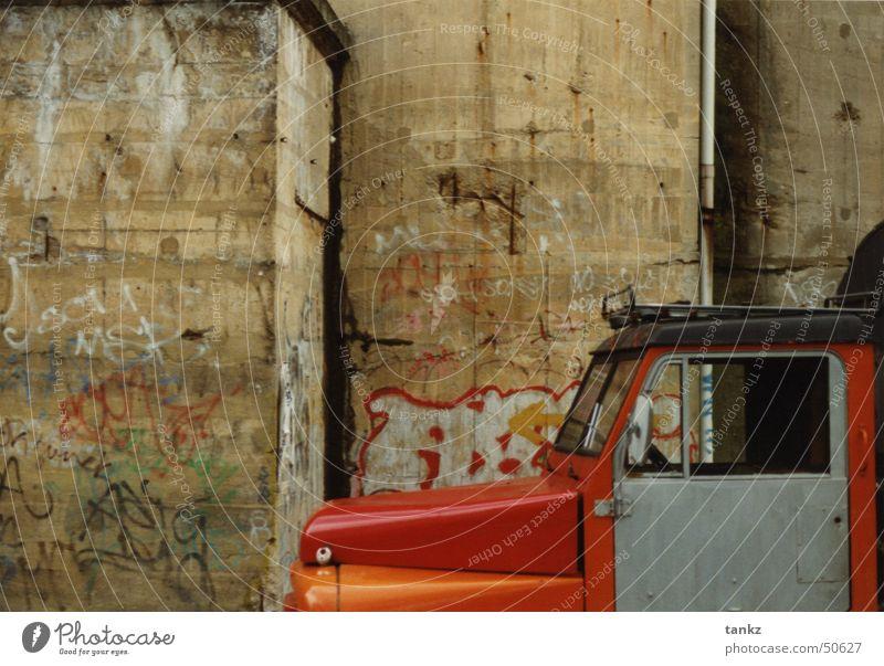 A furious standstill Wall (building) Cavernous Concrete Truck Car Hood Red Exterior shot Dugout Berlin Graffiti driver's cab Orange