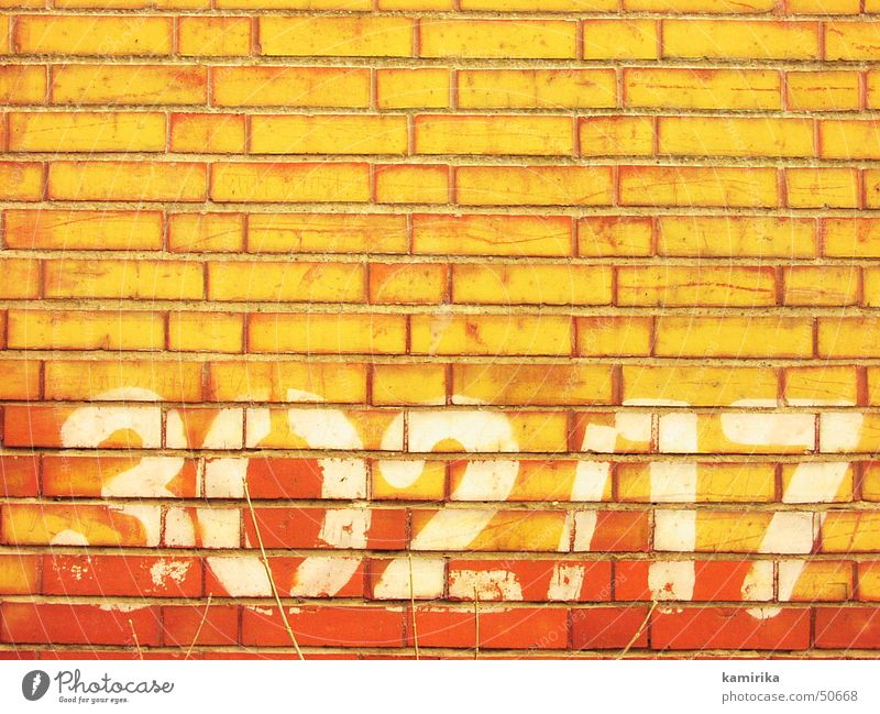 302/17 Wall (building) Wall (barrier) Digits and numbers Brick Red Yellow Abstract Graffiti Bright Sun Shadow
