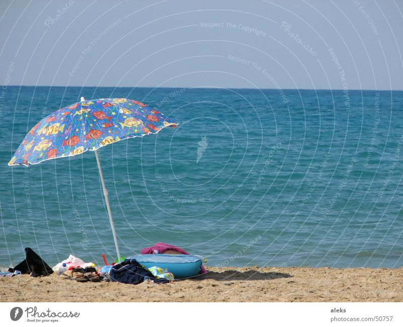 gone for a swim Sunshade Ocean Beach Brown Clothing Luggage Forget Multicoloured Greece Air mattress Blue Sand left Shadow