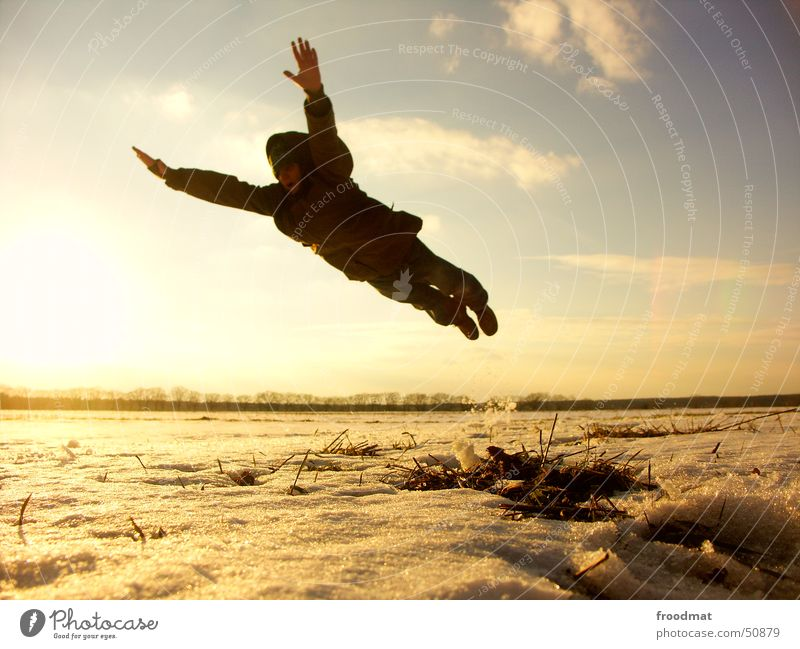 Jump in the deep end Superman Winter Cold Sunset Back-light Frozen Meadow Clouds Action Light heartedness Comic Elated Easygoing Freeze Outstretched Style
