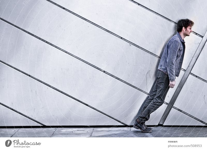 Human being Youth (Young adults) Man Young man Adults Wall (building) Wall (barrier) Gray Line Masculine Facade Modern To fall Tilt Bank building Diagonal
