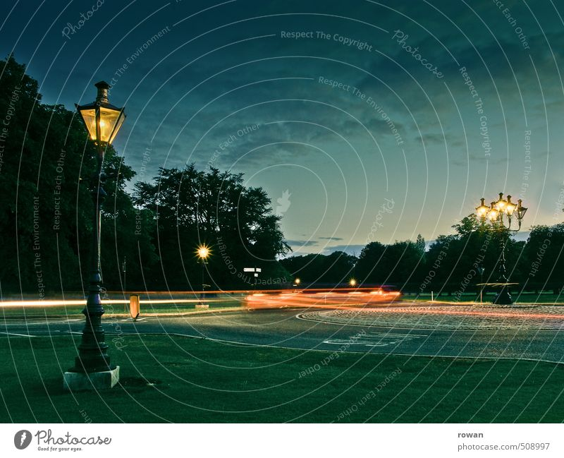 roundabout Park Transport Means of transport Motoring Street Crossroads Lanes & trails Road junction Vehicle Car Dark Traffic circle Light Visual spectacle