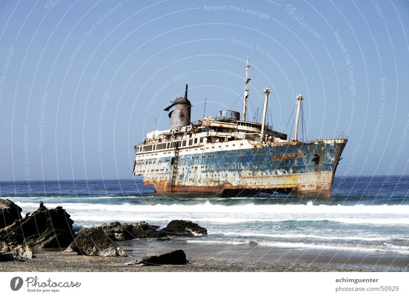 unlucky Fuerteventura Watercraft Waves Ocean Beach Surf Coast Sun American Star Dangerous Sand Stone Rust Threat ghost ship Broken