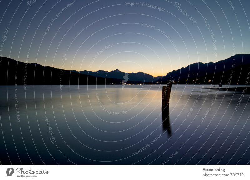 Sky Nature Vacation & Travel Blue Water Summer Sun Relaxation Landscape Calm Black Dark Environment Mountain Coast Lake