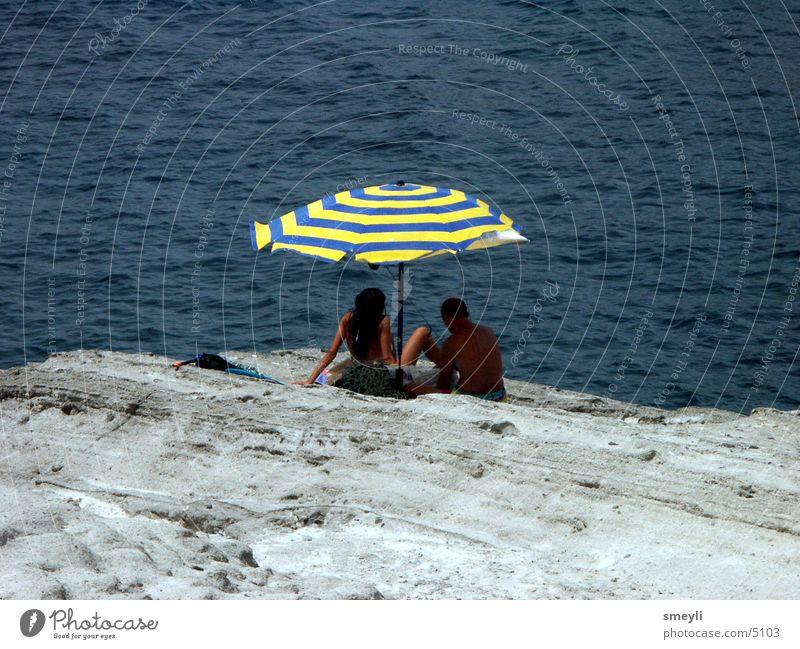 Human being Sun Ocean Beach Vacation & Travel Loneliness Rock Sunshade