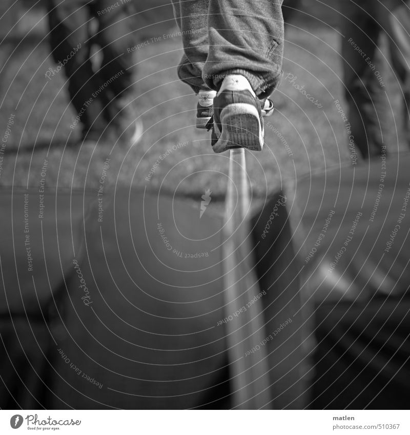 keep track Human being Legs 3 18 - 30 years Youth (Young adults) Adults Cool (slang) balance sneakers tightrope walk Accompany Black & white photo Exterior shot