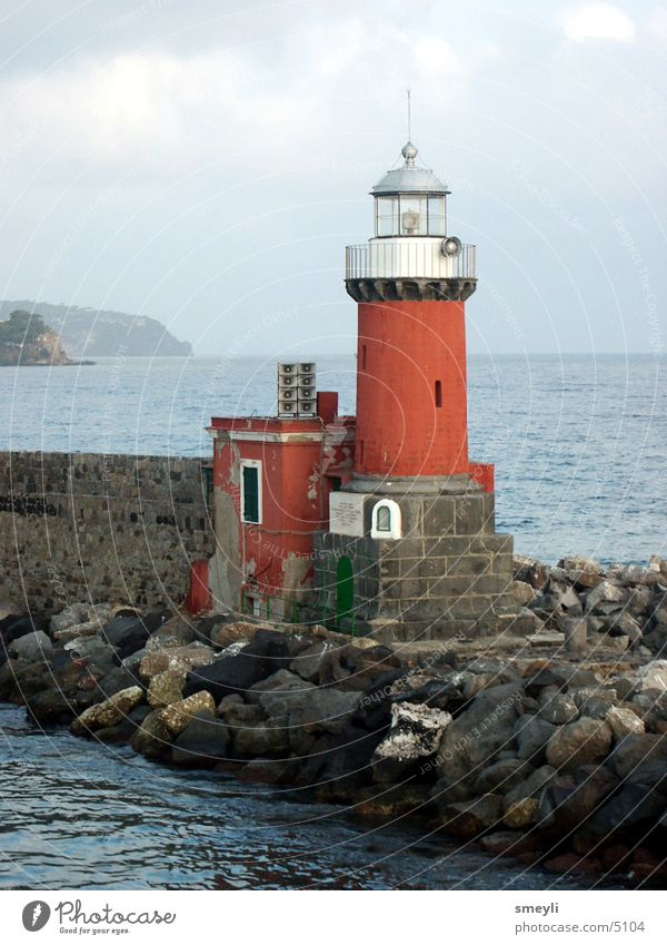 lighthouse Ocean Lighthouse Red Wall (barrier) Jetty Horizon Fisherman Harbour Landmark Monument Water Stone kay Mountain Sky