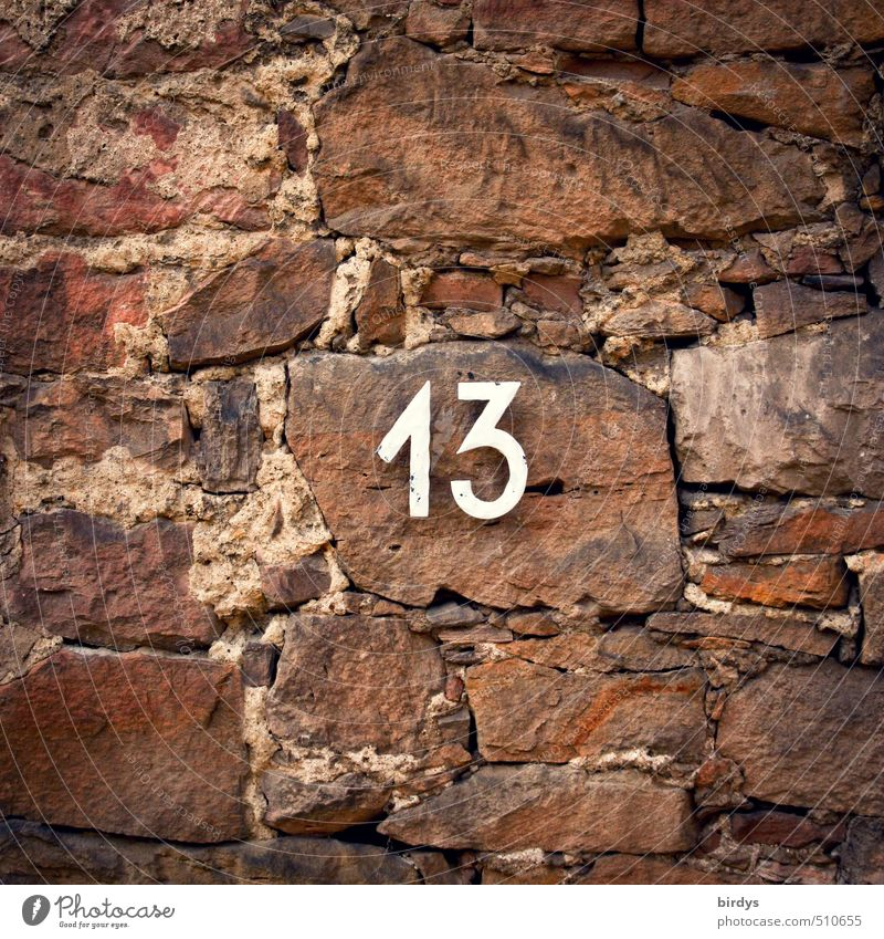 13...so what? Wall (barrier) Wall (building) Stone Sign Digits and numbers Brown Red Popular belief Esthetic Belief Religion and faith Sandstone
