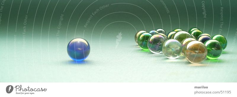 green marbles Playing Children's game Success Work and employment Stone Glass Sphere Movement Round Green Joy Power Might Safety Protection Safety (feeling of)