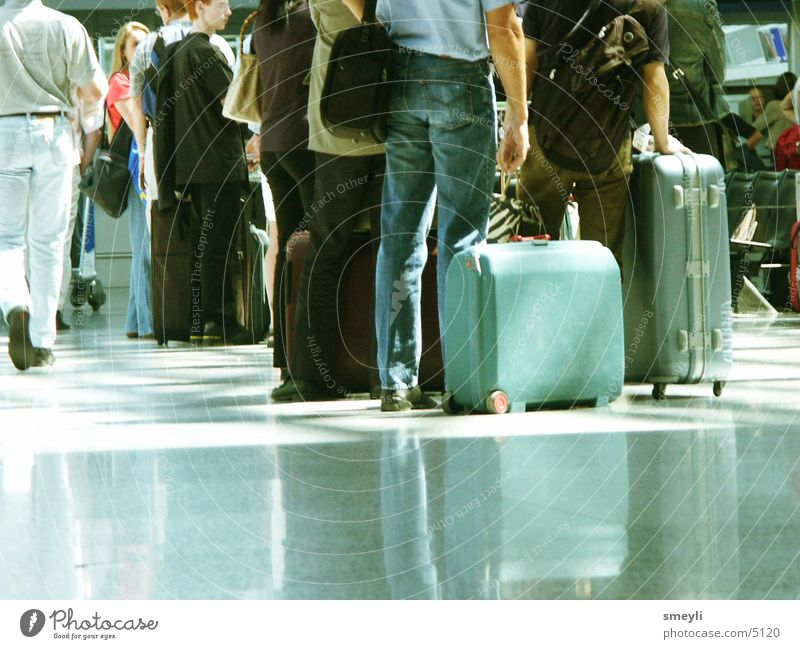 Human being Vacation & Travel Work and employment Group Wait Floor covering Airport Turquoise Train station Bag Warehouse Suitcase Switch Queue Gate