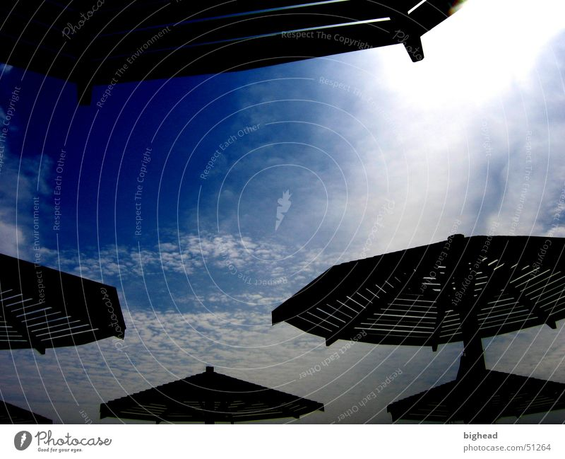 dark sunshades Sunshade UFO Summer Dark Clouds Beach Canopy Bathing place Sky Sunbathing Africa Coast Shadow Blue Contrast Nature