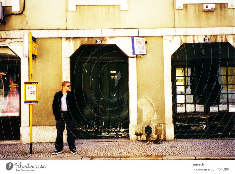On the streets of Lisbon Tram Wall (building) Man Sunglasses Portugal Sidewalk Entrance Street Perspective