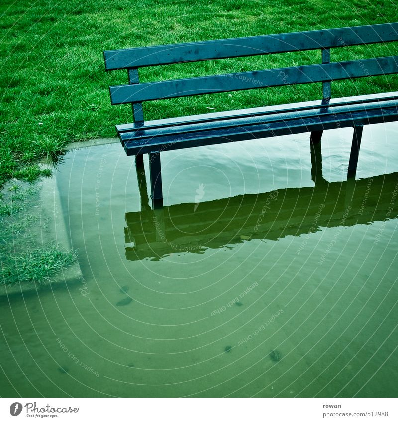 Flooding Grass Threat Bench Deluge Inundated Water Puddle Wet Rainwater Gloomy Comfortless Water damage Storm Colour photo Exterior shot Copy Space bottom Day