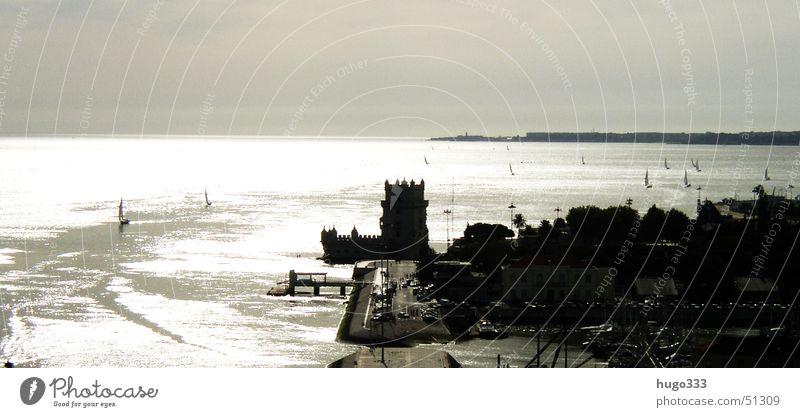 Defense base at the Tejo Lisbon Ocean Watercraft Sailboat Fortress Lake Panorama (View) Tower of Belem River Coast clear vision backlit. Large Panorama (Format)