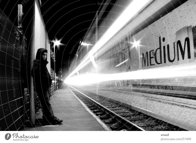 Life goes to fast. . . Railroad Light Black White Night Man Tracer path Calm Railroad tracks Grief upset chase snazz boy train external portrait Sadness sad
