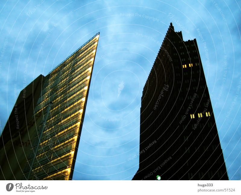 two giants High-rise Dark Threat Large Black House (Residential Structure) Potsdamer Platz Berlin skyscaper Sky Blue aberrant lines Light Few