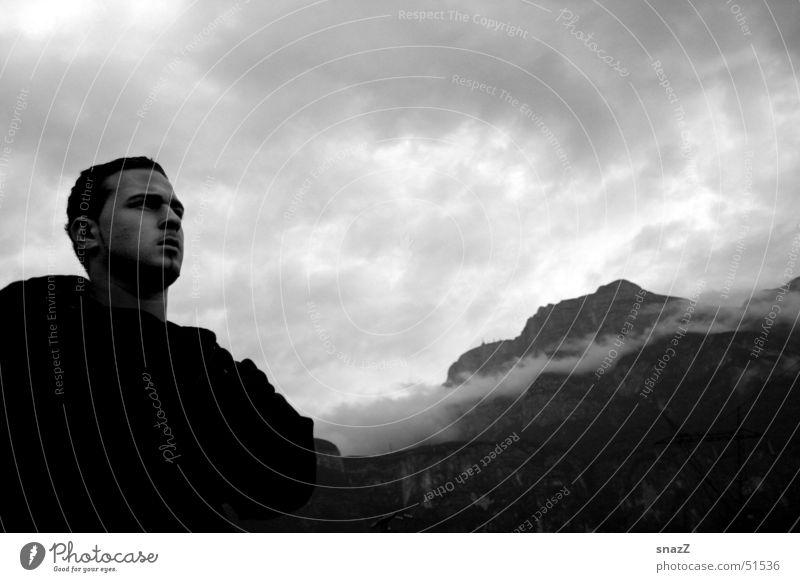 Far away. . . . Man Black White Clouds Far-off places Calm Jacket Italy Portrait photograph snazz upset Mountain Sky Power Graffiti Bright external portrait