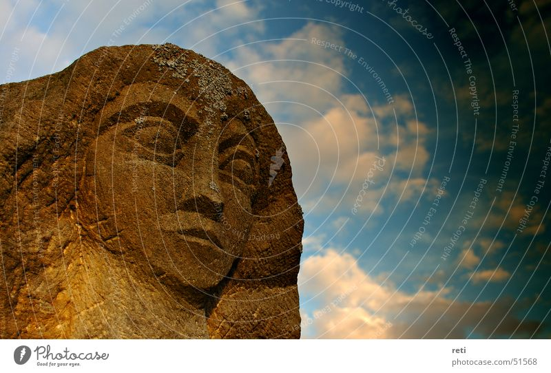 Lord of all time Statue Sandstone Monument Dark clouds Storm clouds Bad weather Weathered Ferocious Facial expression Bust Art Sculptor Head Sky