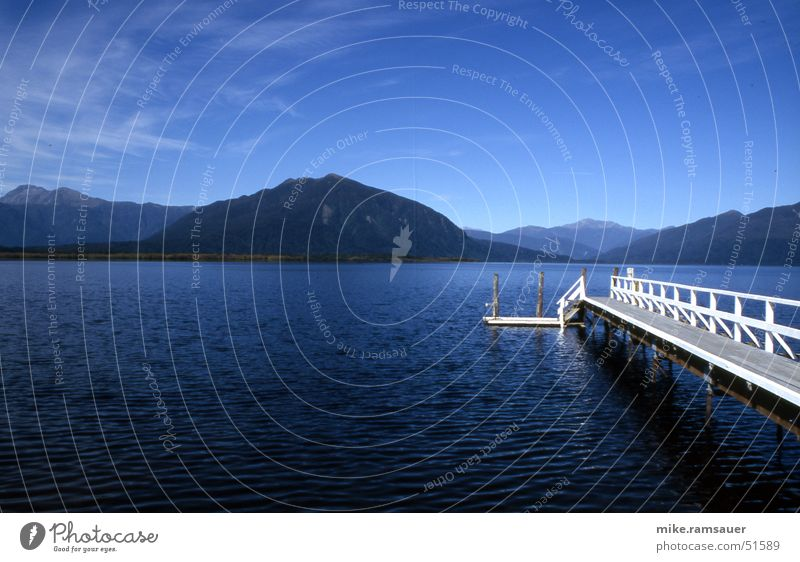 Deep Blue Something Lake Footbridge White Mountain lake New Zealand Panorama (View) Sky Vantage point Looking Large